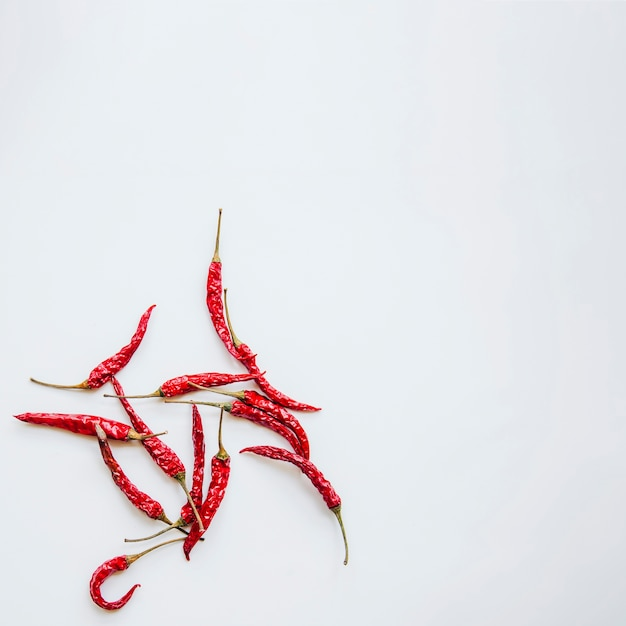 Red chilies against isolated background Free Photo