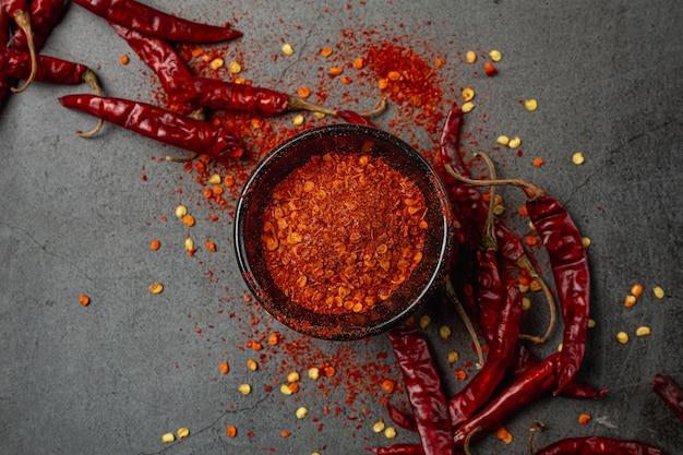 Red chilli paste on black. Free Photo