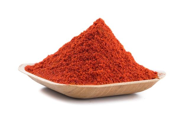 Red chilli pepper powder on white background Premium Photo