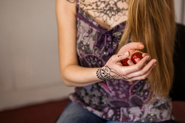 Red chinese balls for relaxation on woman's hand Free Photo
