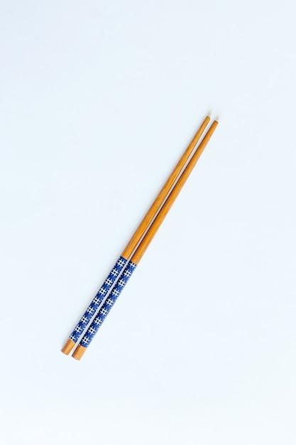 Red chopsticks isolated on white background. isolate Premium Photo