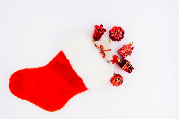 Red christmas sock with toys Free Photo