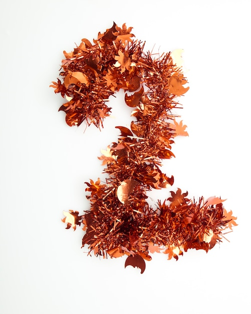 Red christmas tinsel with number Premium Photo