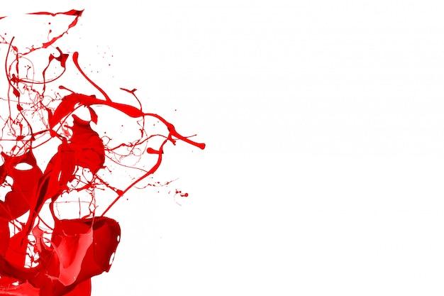 Red color splash dynamic liquid fluid pigment creative background Premium Photo