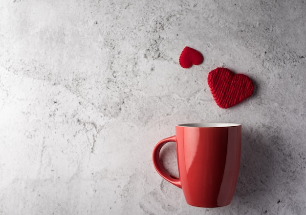 Red cup with heart, valentine's day concept Free Photo