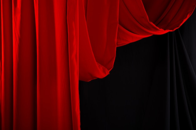 Red curtain drape wave with studio lighting Premium Photo