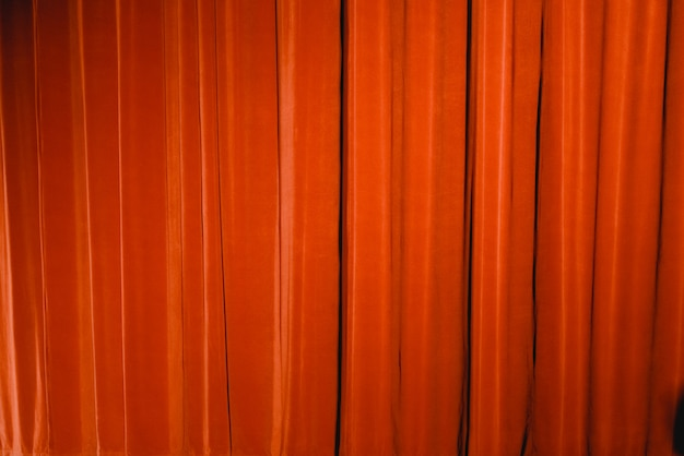 Red curtain of a theater, to use as background of fabrics. Premium Photo