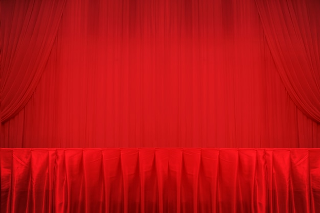 Red curtains and stage and table. Premium Photo