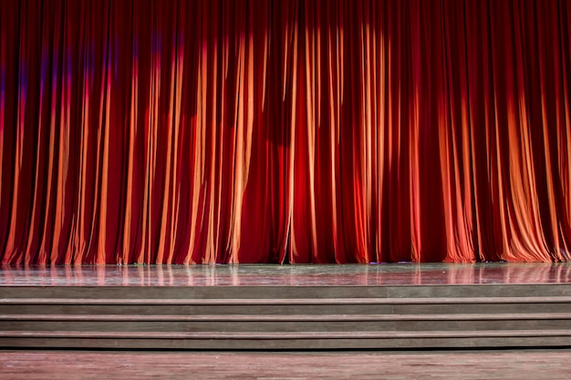 Red curtains and wooden stage. Premium Photo