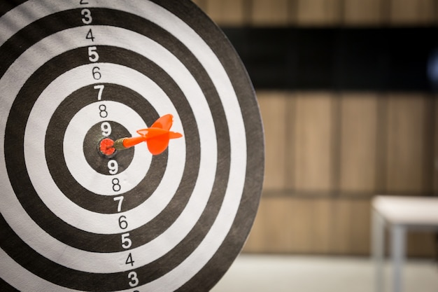 Red dart arrow hitting in the target center. Premium Photo