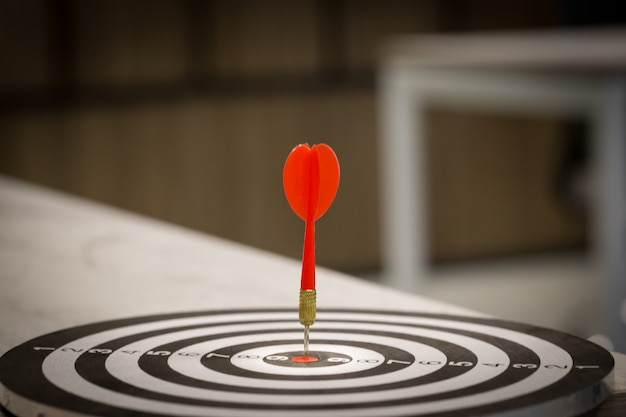 Red dart target arrow hitting on bullseye with, target marketing and business success Premium Photo