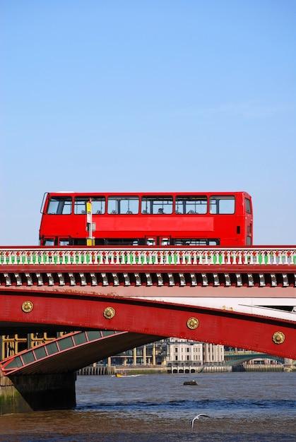 Red double decker bus on blackfriars bridge in london Free Photo
