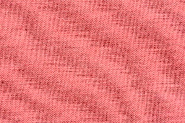 Red fabric canvas macro shot as texture or background