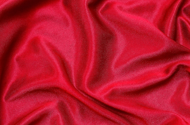 Red fabric cloth texture for background, beautiful crumpled silk or linen. Premium Photo