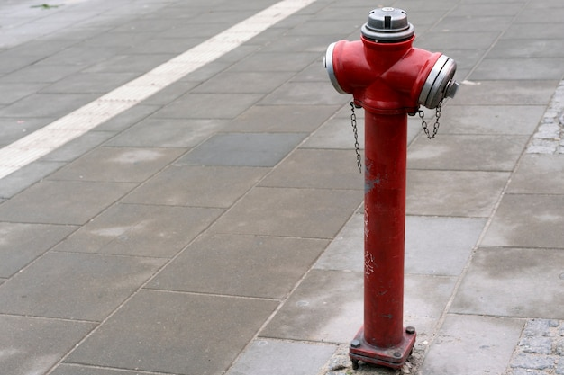 Red fire hydrant in a city street for firefighters Premium Photo