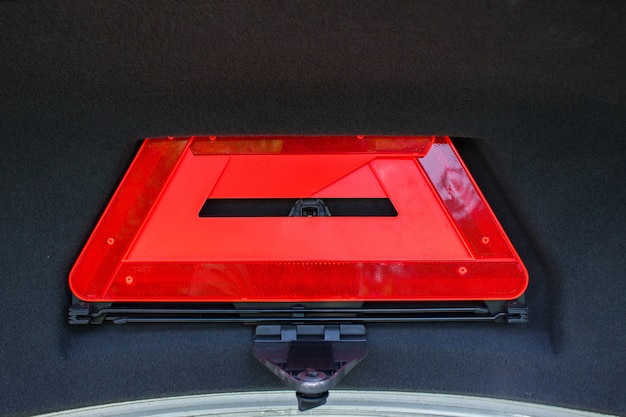 A red folded emergency sign lies in the trunk. Premium Photo