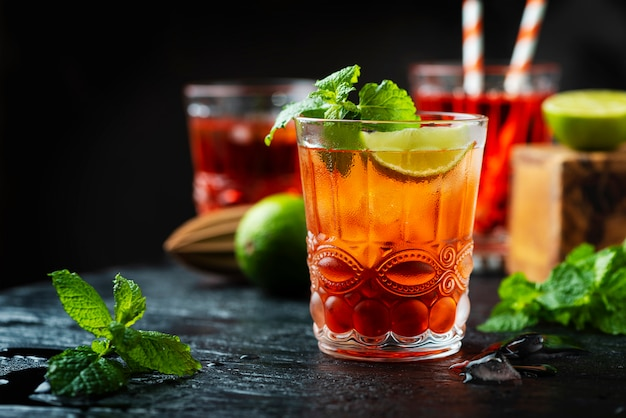 Red fresh cocktail with ice and lime Premium Photo