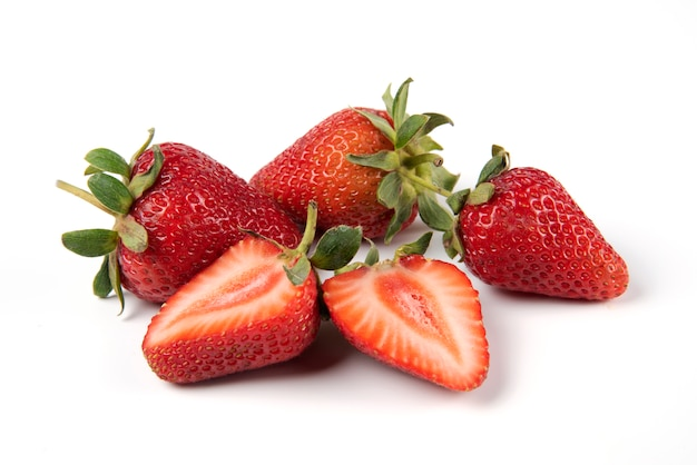 Red fresh strawberries with green leaves Free Photo