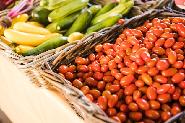 Red fresh tomatoes and organic zucchini at vegetable market Free Photo