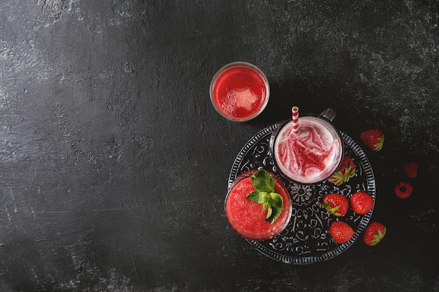 Red fruit cocktails or smoothies Premium Photo