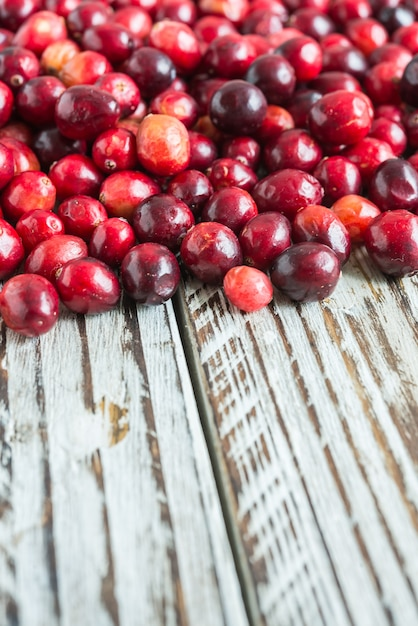 Red fruits on a wooden table Free Photo