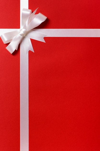 Red gift paper with silver ribbon Free Photo