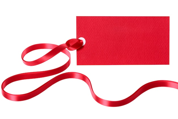 Red gift tag or label with ribbon isolated on white background Free Photo