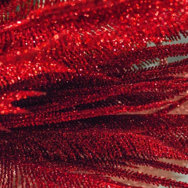 Красный блеск текстуры новогодний фон Premium Фотографии