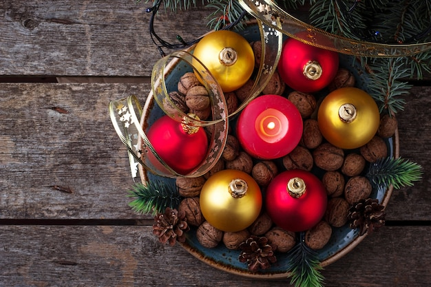 Red and golden christmas balls on plate. selective focus Premium Photo
