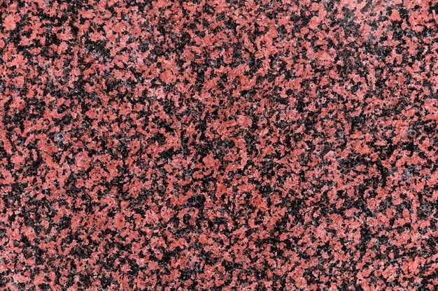 Red granite texture close up Free Photo