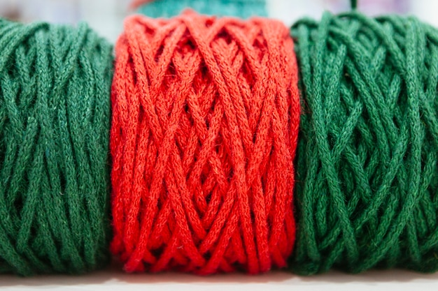 Red and green christmas wool of yarns Premium Photo