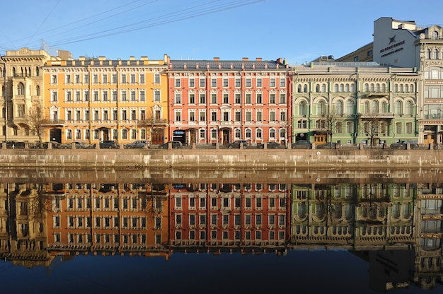 Red green yellow and reflection in the water early morning on the moika river Premium Photo