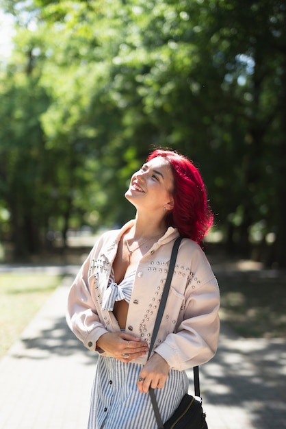 Red haired woman in park Free Photo