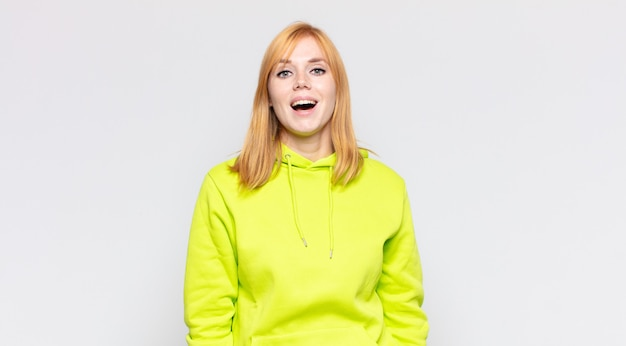 Red head pretty woman with a big, friendly, carefree smile, looking positive, relaxed and happy, chilling Premium Photo