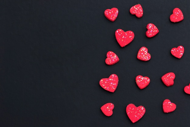 Red heart on black background with copy space for greeting card. valentine's day background concept. Premium Photo