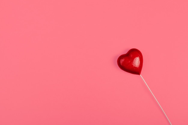 Red heart on color , minimal concept, Premium Photo