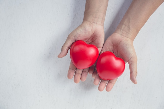 Red heart on girl hand Premium Photo