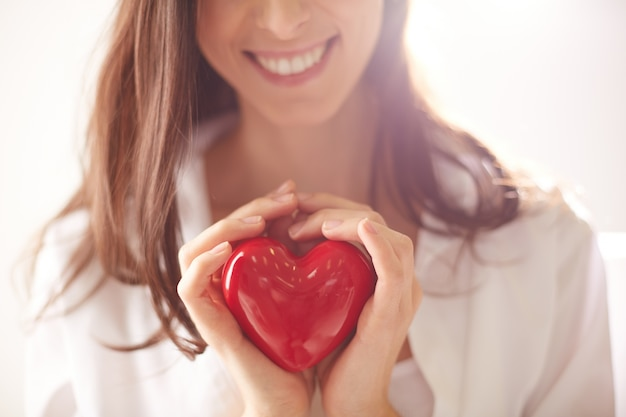 Red heart in the hands of a woman Free Photo
