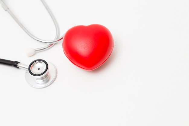 Red heart and a stethoscope. isolated on white. studio lighting. concept for healthy and medical Premium Photo