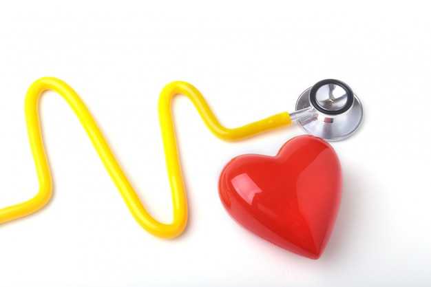 Red heart and a stethoscope on white background Premium Photo