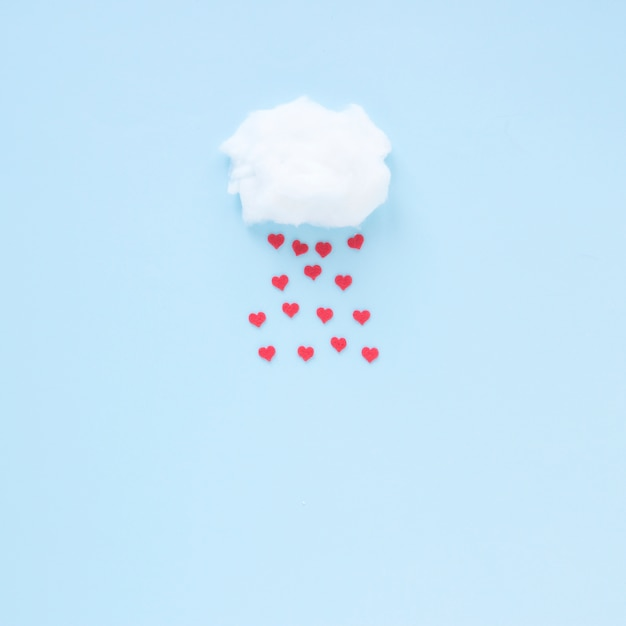 Red hearts falling from cloud Free Photo