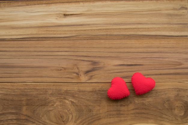 Red hearts on wooden background with copy space for valentine message Premium Photo