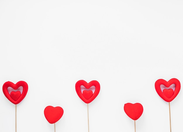 Red hearts on wooden sticks Free Photo