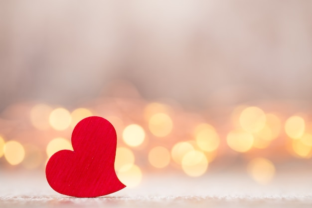 Red hearts on the wooden table. Premium Photo
