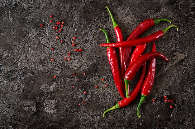 Red hot chili peppers  on grey table. Premium Photo