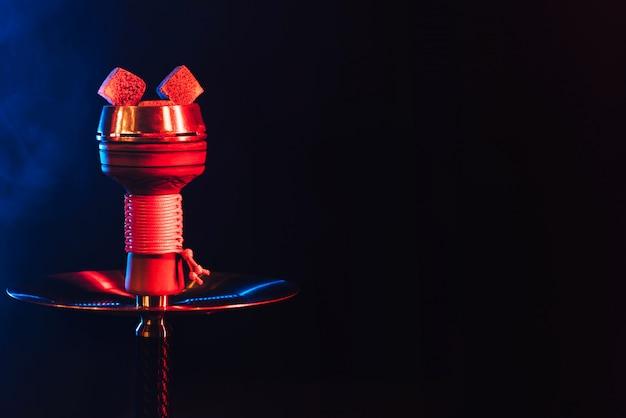 Red hot coals of a hookah in a shisha bowl Premium Photo