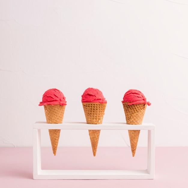 Red ice cream cones in holder Free Photo