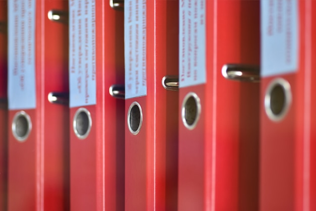 Red large folders files with inscriptions for storing office documents Premium Photo
