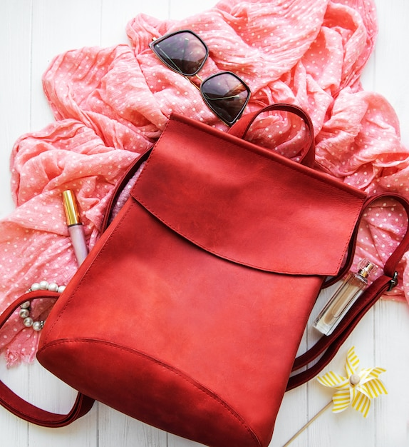 Red leather backpack with  accessories Premium Photo