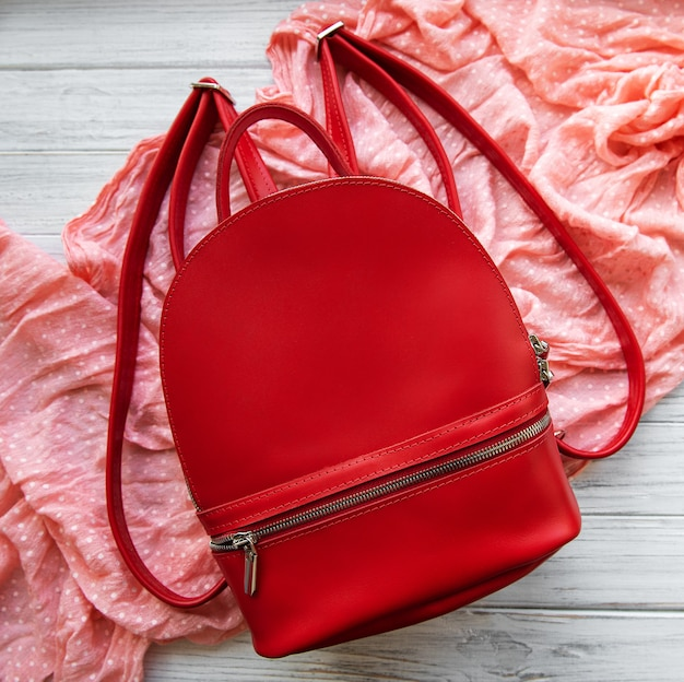 Red leather backpack Premium Photo